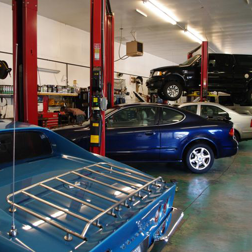 Image of cars in an automotive repair shop