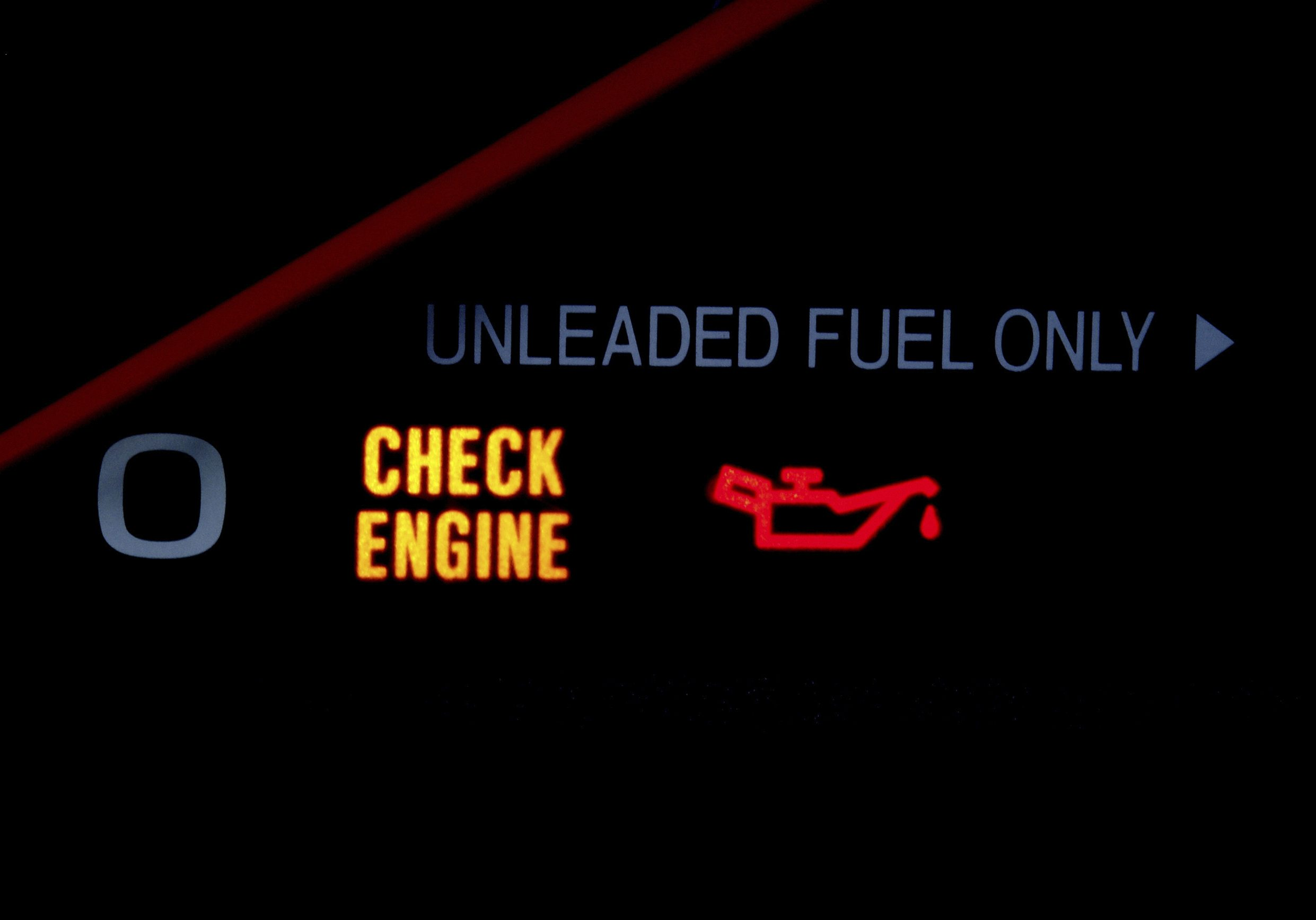 Image of check engine light on a vehicle dashboard
