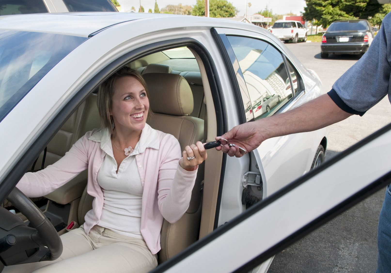 Image of a woman smiling while getting affordable auto repair