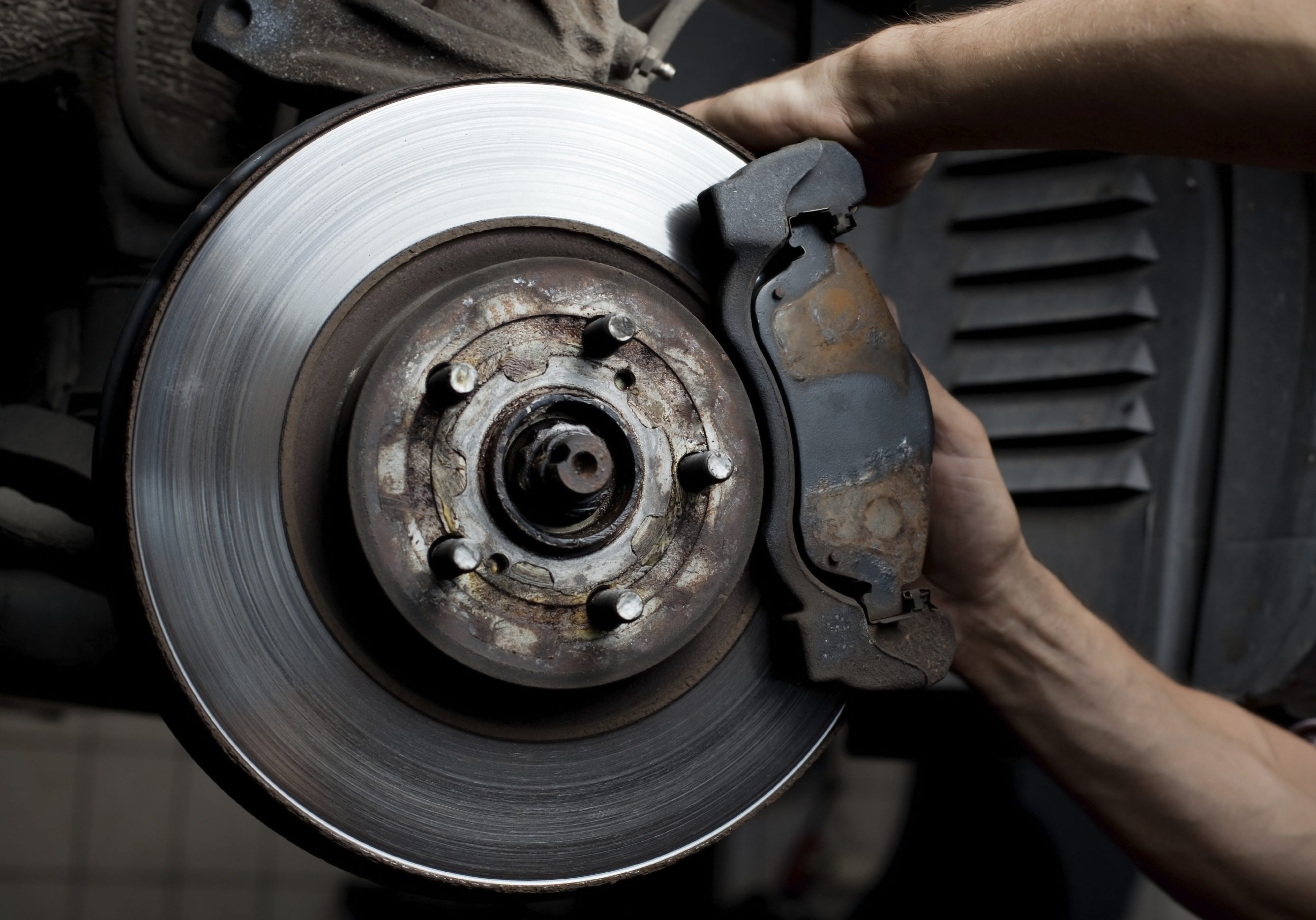 Image of a mechanice completing Puyallup brake repair on a car
